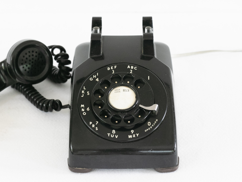 An old style telephone that uses a copper pair traditional analog service rarely used in homes and businesses today.